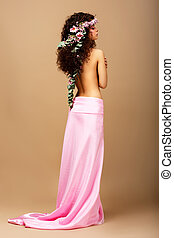 Freshness. Tenderness. Gorgeous Curly Hair Brunette with Wreath of Flowers