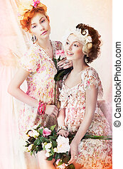 Freshness. Two Young Pretty Women in Classic Vintage Dresses...