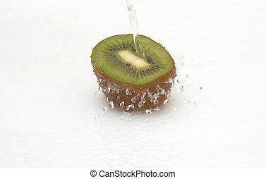 Fresh,ripe, shaggy kiwi in cool streaming water.