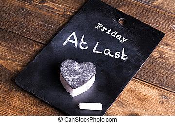 Friday at last blackboard concept