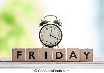 Friday sign with wooden blocks and a classic clock