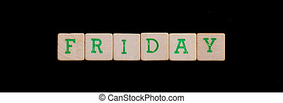 Friday spelled out in old wooden blocks