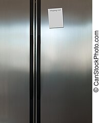 Fridge - A modern duel stainless steel kitchen fridge