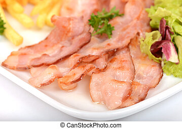 fried bacon on a white plate