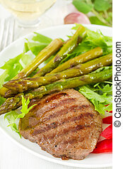 fried beef with boiled asparagus and salad