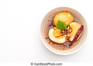 Fried Boiled Egg with Tamarind Sauce isolated on white...