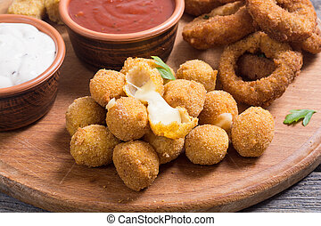 Fried breaded cheese balls with sauces