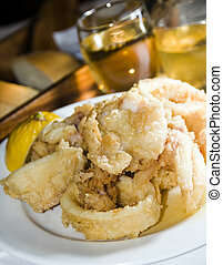 fried calamari squid greek food taverna specialty with home made wine as photographed in the greek islands santorini