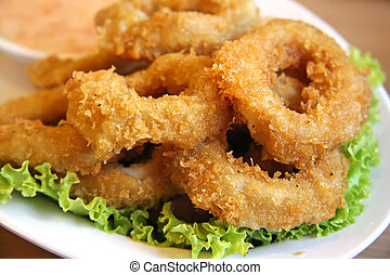 Fried calamari - Deep batter fried squid rings calamari in...