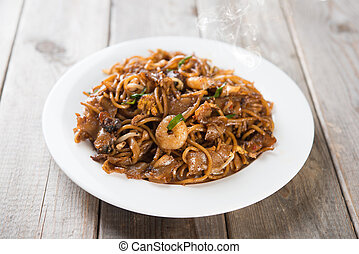 Fried Char Kuey Teow, popular noodle dish in Malaysia and...
