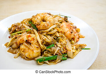Fried Char Kway Teow is a popular food in Malaysia and...