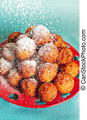 sprinkled with powdered sugar - Fried cheese balls sprinkled...