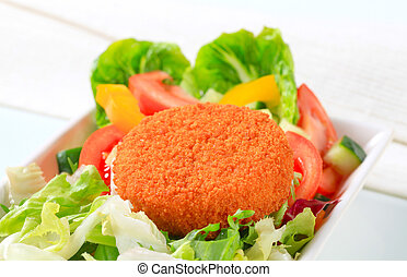 Fried cheese with vegetable salad