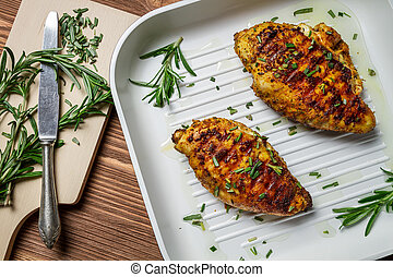 Fried chicken breast with rosemary