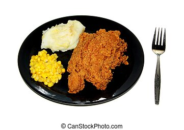 Fried Chicken Dinner - A fried chicken dinner on a white ...