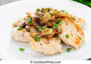 Fried chicken fillet with mushrooms