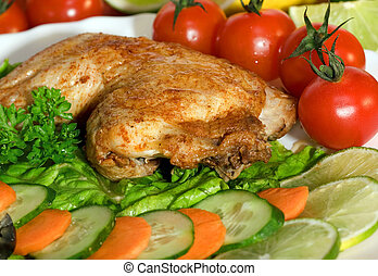 Fried chicken leg with lemon and cucumber