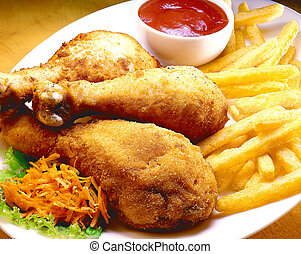 Fried chicken legs served with fries, vegies and ketchup.