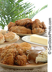 Fried Chicken - a table heaped with fried chicken, mashed...