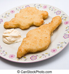 fried chicken pieces on a plate served with mayonnaise