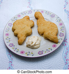 fried chicken pieces on a plate serverd with mayonnaise