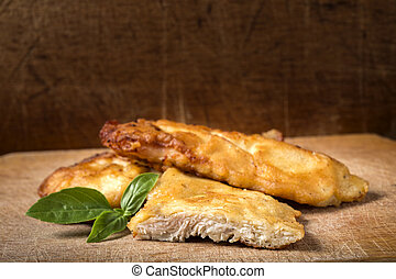 Fried chicken schnitzel with basil