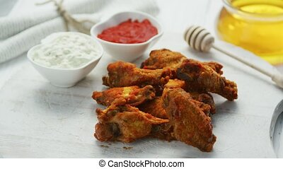Fried chicken wings in served