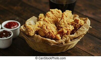 Fried chicken wings near sauces and drink - Bowl of yummy...