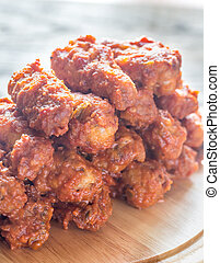 Fried chicken wings on the wooden board