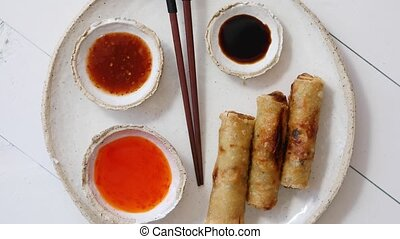 Fried Chinese Thai or Vietnamese traditional spring rolls or...