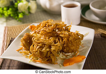 Fried chinese wanton vermicelli on white plate