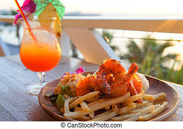 Fried chips with shrimps and juicy fruit in resort
