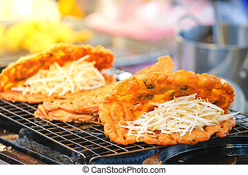 Fried clams are available for sale at Street Food Thai Style.