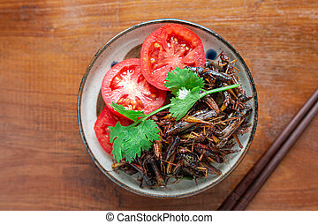 Fried Crickets, Insect food with Vegetables, Tomato in the ...