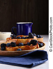 fried croutons with fresh berries for breakfast