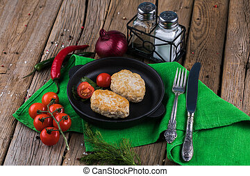 Fried cutlet with tomatoes on a plate