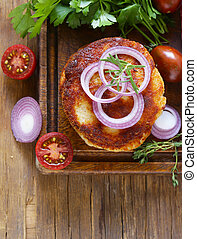 fried cutlets with herbs and onions