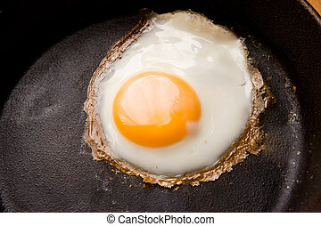 Fried Egg Detail - Detail image of a fried egg on a cast...