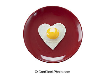 fried egg in heart shape served in a plate