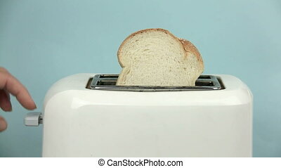 Edited sequence of a slice of bread being toasted then adding a fried egg.
