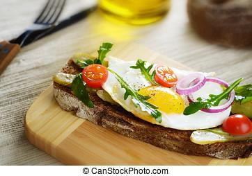 Fried egg open sandwich - Fried egg and greens open sandwich...