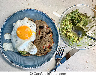 Fried Egg with Avocado on Toast Bread for Breakfast