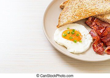 fried egg with bread toasted and bacon