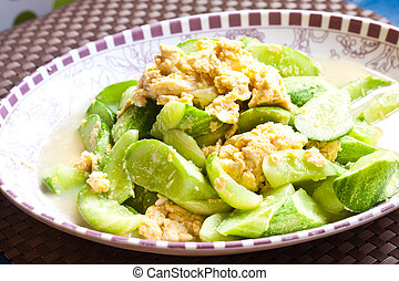 Fried egg with cucumber