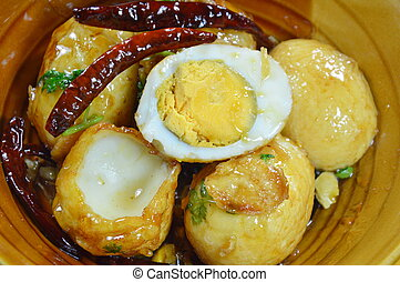 fried egg with tamarind sauce on bowl