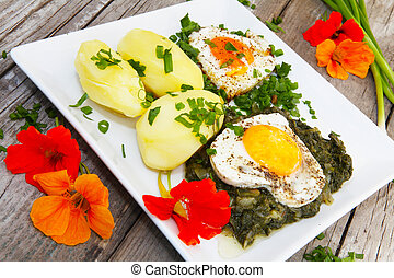 Fried eggs and spinach