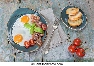 Fried eggs,  bacon, tomato and toast