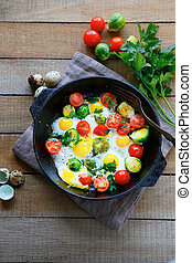 fried eggs in a pan, top view