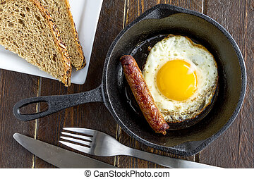 Fried Eggs in Cast Iron Skillet - Single fried egg and ...