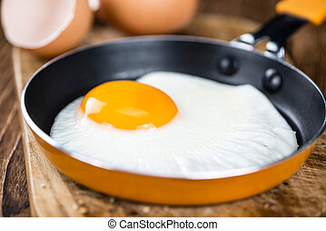 Fried Eggs - Old wooden table with fried eggs (selective ...